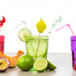 Selection of fruits non alcoholic cocktails over white — Stock Photo #75348467