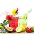 Exotic summer fruits cocktail over white — Stock Photo #75348609
