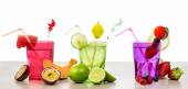 Selection of fruits non alcoholic cocktails over white — Stock Photo