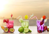 Iced fruits cocktail over relaxing seascape — Stock Photo