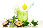 Refreshing cocktail with lime and passion fruit over white — Stock Photo