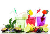 Exotic fruits cocktail against white background — Stock Photo