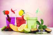 Fruits cocktails over pink background — Stock Photo