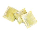 Raw home made ravioli over white — Stock Photo