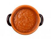 Tomato sauce, inside earthenware bowl — Stock Photo