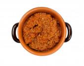 Ragout sauce inside earthenware pot — Stock Photo