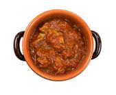 Boletus sauce with tomato inside earthenware pot — Stock Photo