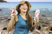 Smiling girl with flip-flop to the beach — Stock Photo