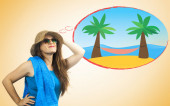 Girl with summer clothes dreaming of an exotic island with hammo — Stock Photo