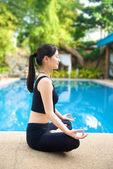 Asian Girl meditating yoga — Stock Photo