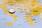 Euro coin on Mediterranean County map. — Stock Photo