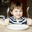 Happy little boy waiting for dinner.  — Stock Photo #70261249