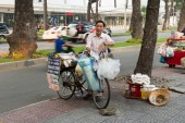 Street vendor with bike — Stock Photo
