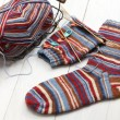 Knitting winter warm socks, yarn ball and knitting needles — Stock Photo #57997743