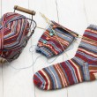Knitting winter warm socks, yarn ball and knitting needles — Stock Photo #57997747