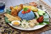 Nasi kerabu, blue color rice salad, malaysian cuisine — Stock Photo
