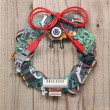Geeky christmas wreath made by old computer parts hanging on wooden door — Stock Photo #60463177