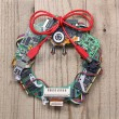 Geeky christmas wreath made by old computer parts hanging on wooden door — Stock Photo #60463179