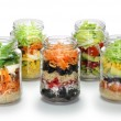 Salad in glass jar on white background, no lid — Stock Photo #66826179