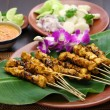 Chicken satay with peanut sauce, indonesian skewer cuisine — Stock Photo #67262515
