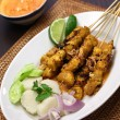 Chicken satay with peanut sauce, indonesian skewer cuisine — Stock Photo #67262517