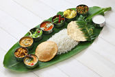 South indian meals served on banana leaf — Stock Photo