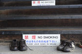 Shoes outside of a Buddhist Temple — Stock Photo