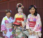 Three geishas — Stock Photo