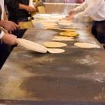 Mens Making talos, Tortilla than wraps txistorra. — Stock Photo #72767079