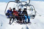 Skiers in ski lift — Stock Photo