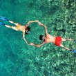 Romantic couple snorkeling in Phi Phi island, Thailand — Stock Photo #63795543