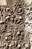 Detail of carved stone with grape — Stock Photo