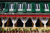 King palace with green shutters and flower pots. Durbar square,  — Stock Photo