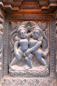 Erotic wooden carving motif on a Hindu temple in Nepal — Stock Photo