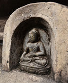 Bas relief statuette of sitting Buddha in Swayambhunath. Now des — Stock Photo
