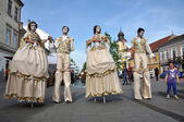 Artists on stilts performing in medieval costumes — Stock Photo