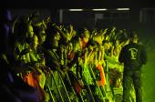 Party people in the golden circle at a concert — Stock Photo