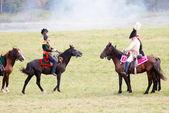 Reenactors dressed as Napoleonic war soldiers ride horses. — Stock Photo
