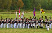 Reenactors dressed as Napoleonic war soldiers stand on the battle field. — Stock Photo