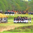Постер, плакат: Reenactors dressed as Napoleonic war soldiers fight on the battle field