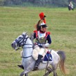 Reenactor dressed as Napoleonic war soldier rides a horse. — Stock Photo #53147389