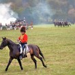 Reenactor dressed as Napoleonic war soldier rides a horse. — Stock Photo #53147405