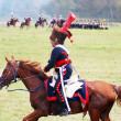 Reenactor dressed as Napoleonic war soldier rides a horse. — Stock Photo #53147433