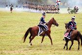 Reenactors dressed as Napoleonic war soldiers ride horses — ストック写真