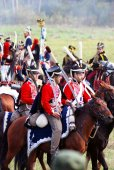 Reenactors dressed as Napoleonic war soldiers ride horses — Стоковое фото