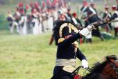 Reenactor dressed as Napoleonic war soldier rides a horse. — Stock Photo
