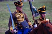 Reenactors dressed as Napoleonic war soldiers ride horses — Stock Photo