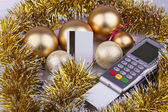 Business Christmas of payment terminal, credit Cards, balls, tinsel — Stock Photo