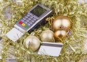 Business Christmas of payment terminal, credit Cards, balls, tinsel — Stock Photo