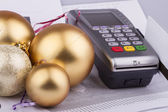 Business Christmas of a tables, payment terminal, credit Cards, balls — Stock Photo